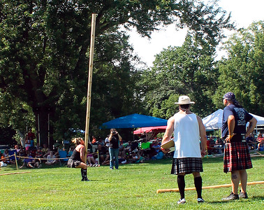 Caber chick setting up the throw...