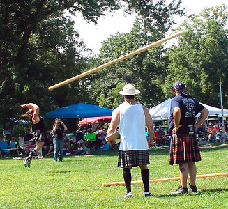Caber chick tosses a winner!  Well, you know what I mean...