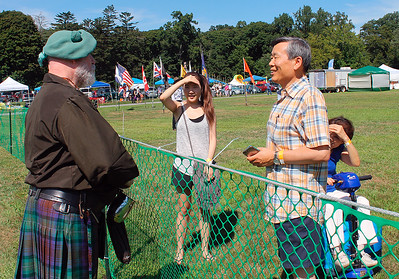Bear is a Scottish guy speaking Korean to very surprised Korean folks at the Scottish Highland games.