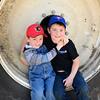 boys sitting on large tire