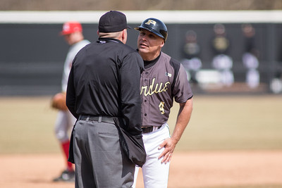 Purdue head coach Doug Schreiber argues a call during the Sunday matinee against Rutgers at Alexander Field