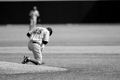 Rutgers pitcher Gaby Rosa says a prayer prior to his start against Purdue at Alexander Field