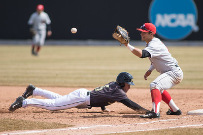 Evan Kennedy dives back into first base against Rutgers