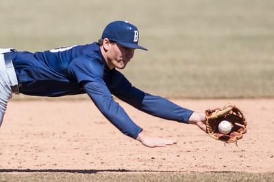 Butler third baseman Mike Kseniak makes a diving stop against Purdue