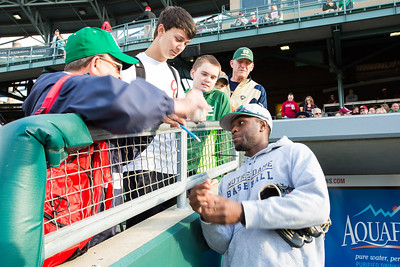 Torii Hunter Jr. signs an autograph for a fan prior to the Notre Dame baseball game against Indiana on April 21, 2015