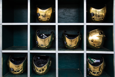 The golden helmets of Notre Dame baseball sit in the dugout prior to the Notre Dame baseball game against theIndiana Hoosiers at Victory Field on April 22, 2015