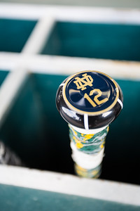 The bat of Brandon Bielak sits in the Notre Dame dugout prior to the Notre Dame baseball game against theIndiana Hoosiers at Victory Field on April 22, 2015