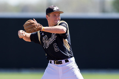 Harry Shipley throws to first during the Purdue baseball game against Maryland on April 26, 2015