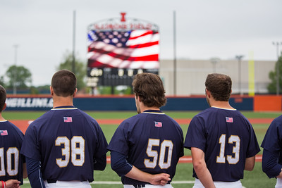 Members of the Notre Dame baseball team stand for the National Anthem prior to NCAA Champaign Regional Game between Notre Dame and Illinois on May 31, 2015