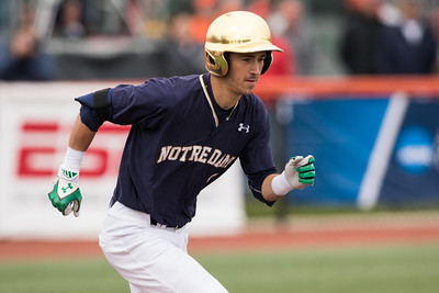 Jake Shepski runs to first during the NCAA Champaign Regional Game between Notre Dame and Illinois on May 31, 2015