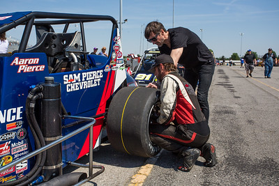 Aaron Pierce checks his rear tire prior to the Day Before the 500 race at Lucas Oil Raceway in Speedway, Indiana on May 23, 2015.