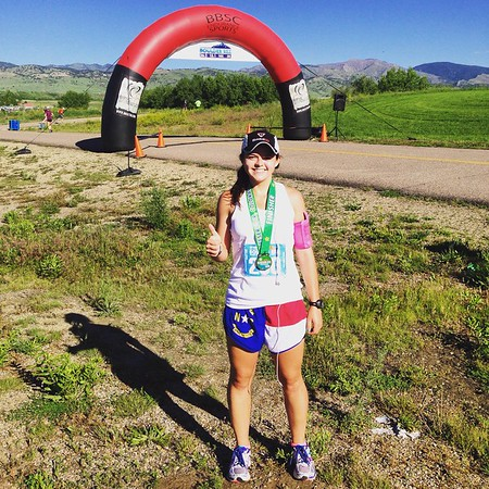 After running the Boulder Reservoir 10k race. Got third place in my age group! Of course I'm representing my North Carolina roots!