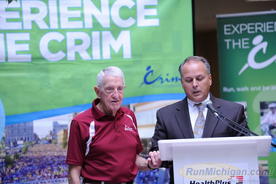 Crim race co-founder Bobby Crim (left) is honored by HealthPlus of Michigan CEO Dr. Michael Genord at the 2015 HealthPlus Crim Festival of Races Pre-Race Press Event on August 19.