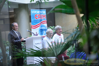 Harry Binder (front left) and Darrell McKee (front right) are honored at the 2015 HealthPlus Crim Festival of Races Pre-Race Press Event on August 19.