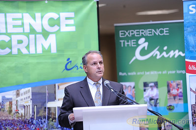 HealthPlus of Michigan CEO Dr. Michael Genord speaks at the 2015 HealthPlus Crim Festival of Races Pre-Race Press Event on August 19.