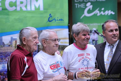 HealthPlus of Michigan CEO Dr. Michael Genord poses with long-time Crim runners Darrel McKee (second from right), Harry Binder (second from left) and Bobby Crim (left) at the 2015 HealthPlus Crim Festival of Races Pre-Race Press Event on August 19.