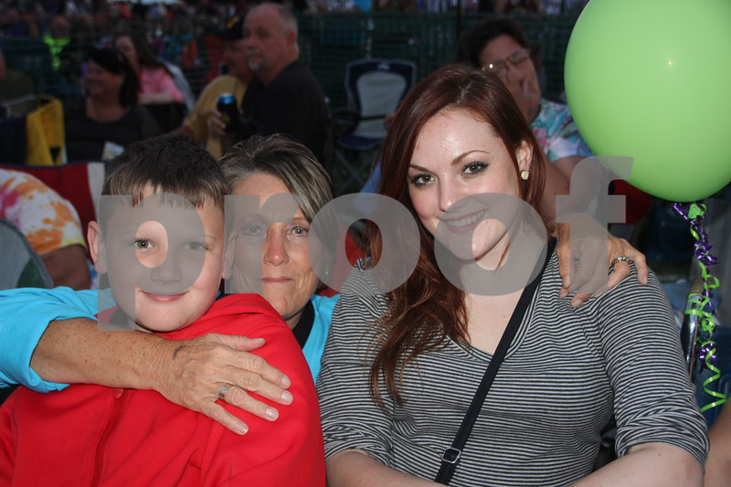 Seen here (left to right) is : Lawson, Martha, and Baylee O Brien enjoying the Boston concert  at the 2015 Shellabration  at Harlan Rogers on June 26, 2015.