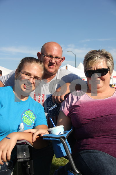Shown here are left to right: Allyssa Anderson, Tom Gilbert, and Vicki Gilbert. They attended the Boston Concert on June 26, 2015 as a part of the 2015 Shellabration at Harlan Rogers