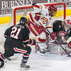 Pictured:  SCSU:  #35, Charlie Lindgren, G, 6-2, 190, SO, Lakeville, MN; #21, Brooks Bertsch, F, 5-11, 190, SR, Dubuque, IA;  DU:  #21, Joey LaLeggia, D, 5-10, 185, SR, Burnaby, BC
