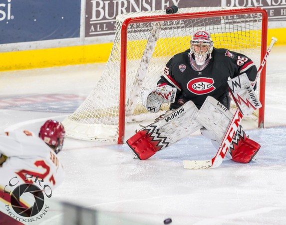 Pictured:  SCSU:  #35, Charlie Lindgren, G, 6-2, 190, SO, Lakeville, MN;  DU:  #27, Quentin Shore, F, 6-1, 185, JR, Denver, CO