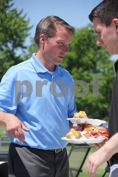 Todd Redenius grabs a quick bite before heading to the club house to load several carts with a variety of beverages for the volunteers and golfers throughout the 18 hole golf course. The Fort Dodge Country Club held the Swing for A Cure event to raise money for diabetes on Friday, June 19, 2015.