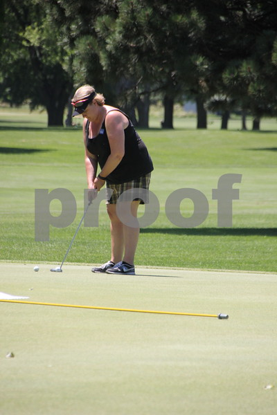 Jenny Condon takes her best shot at  the Swing for A Cure event held on Friday, June 19, 2015 at the Fort Dodge Country Club. The event was to raise money for diabetes.