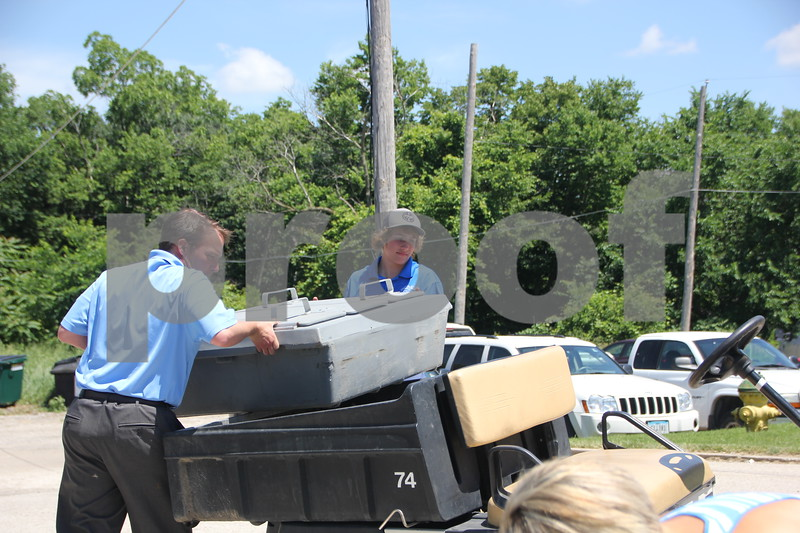 On Friday, June 19, 2015, the Fort Dodge Country Club held the Swing for A Cure event to raise money for diabetes. Seen here are (left to right): Todd Redenius and Eirk Birnbaum as they load up one of many carts  with beverages to distribute to the golfers and volunteers around the golf course.
