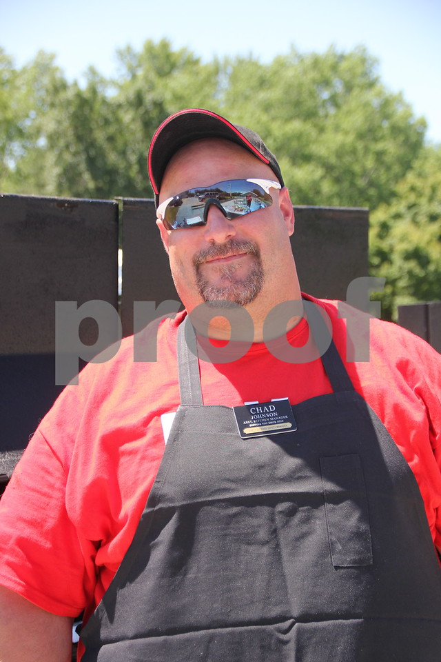 Chad Johnson from Hy-Vee is seen here  grilling up brats and other  items for the many golfers taking part in the recent  Swing for A Cure  event  and those in attendance, on Friday, June 19, 2015 taking place at the Fort Dodge Country Club.The event is raising  money for diabetes.