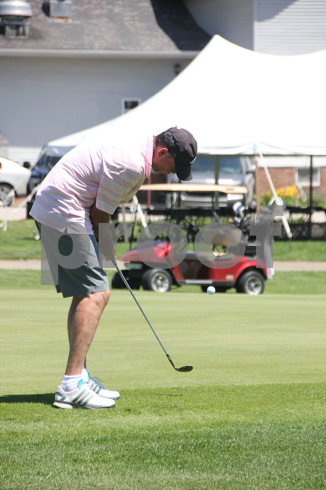 Steve Hendricks takes some practice shots at the Fort Dodge Country Club where the Swing for A Cure event was held on Friday, June 19, 2015 to raise money for diabetes.