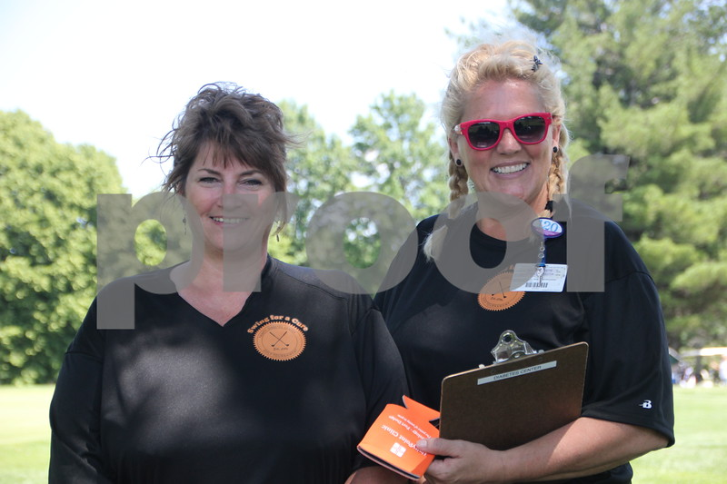 These two ladies were just some of the volunteers that assisted the numerous golfers and other volunteers at the Swing for A Cure event for diabetes held at the Fort Dodge Country Club on Friday, June 19, 2015.