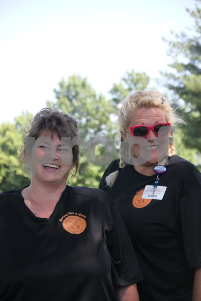 Left to Right are : Sue Koob and Andrea Grimsley. These ladies  were just a couple of  the many volunteers assisting the golfers and other volunteers at the Swing for A Cure event for diabetes that took place at the Fort Dodge Country Club on Friday, June 19, 2015.