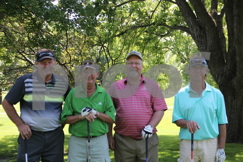 Here is (from left to right) : Wayne Green, Dan Allen, Kirk Warnke, and Greg Moore as they stop for a picture before heading to the next of 18 holes on the course at the Fort Dodge Country Club. Their sponsor is the Green Brothers. They took part in the Swing for A Cure event held at the Fort Dodge Country Club for diabetes on Friday, June 19, 2015.