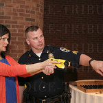 Lisa Russell took aim with a taser gun as Brian Kuriger gave her instructions.