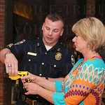 Brain Kuriger instructed Terri Duncan on how to hold and aim a taser gun.