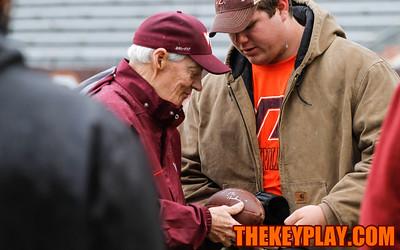 Head coach Frank Beamer signs a football for a fan before the spring game. (Mark Umansky/TheKeyPlay.com)