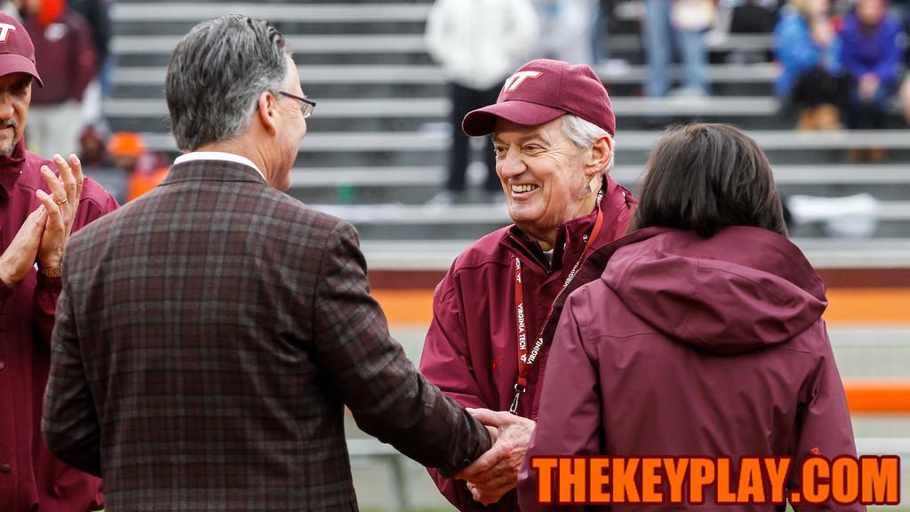 Head coach Frank Beamer shakes the hand of Virginia Tech President Dr. Timothy Sands. (Mark Umansky/TheKeyPlay.com)