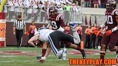 Duke quarterback Thomas Sirk dives towards the endzone on a quarterback keeper as Chuck Clark (19) tries to make the tackle. (Mark Umansky/TheKeyPlay.com)