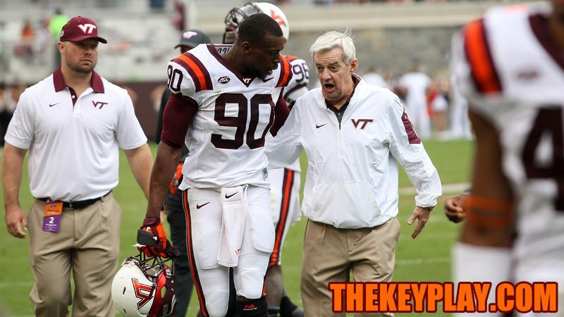 Dadi Nicolas (90) and Frank Beamer have a conversation as they head to the locker room at the half. (Mark Umansky/TheKeyPlay.com)