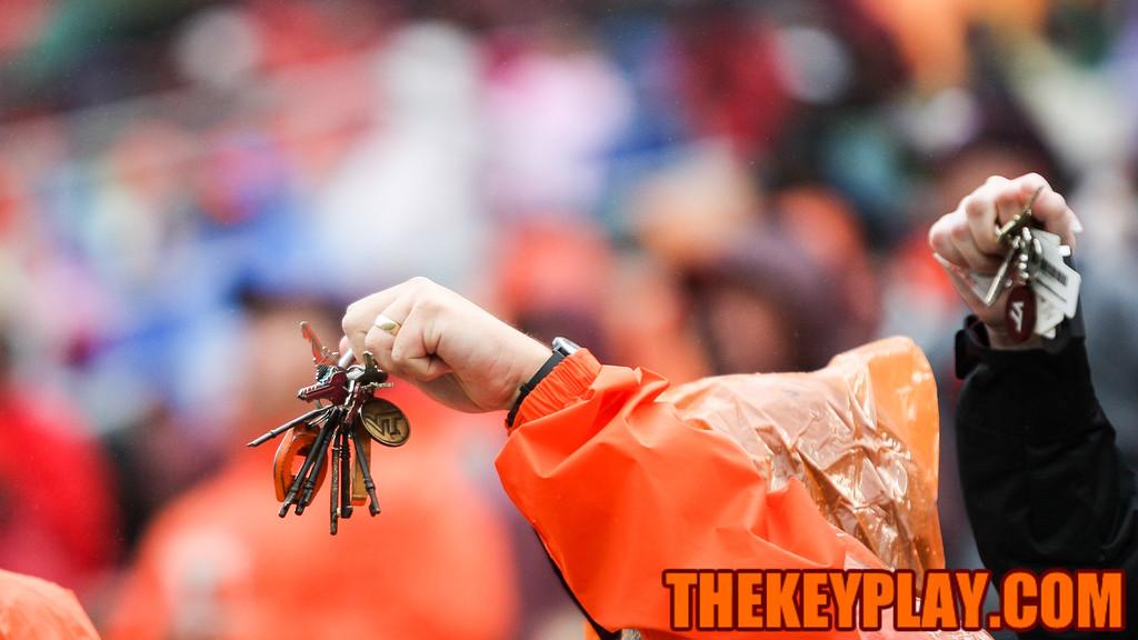A Virginia Tech fan shakes her keys on a third down. (Mark Umansky/TheKeyPlay.com)