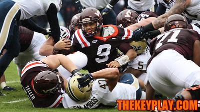 Virginia Tech QB Brenden Motley (9) gets sacked for a loss. (Mark Umansky/TheKeyPlay.com)