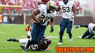 Pittsburgh RB Qadree Ollison tries to escape a tackle by Virginia Tech's Chuck Clark. (Mark Umansky/TheKeyPlay.com)