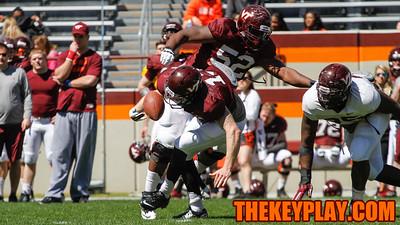 QB Chris Durkin loses control of the football after the snap. (Mark Umansky/TheKeyPlay.com)