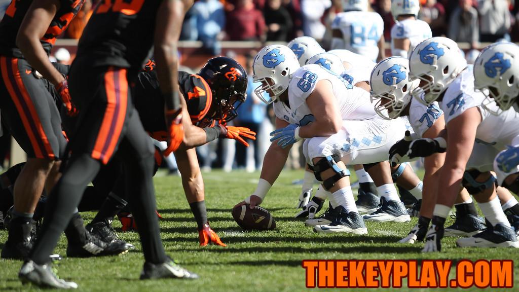 The Hokies' defensive line waits for the UNC snap. (Mark Umansky/TheKeyPlay.com)