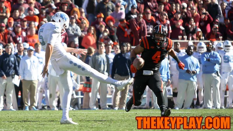 DE Ken Ekanem tries to block the punt from UNC's Joey Mangili. (Mark Umansky/TheKeyPlay.com)