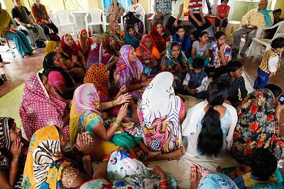 Ladies from the village singing at Dr Guptas Ayurdedic Medicine Making Facility in Vrindavan