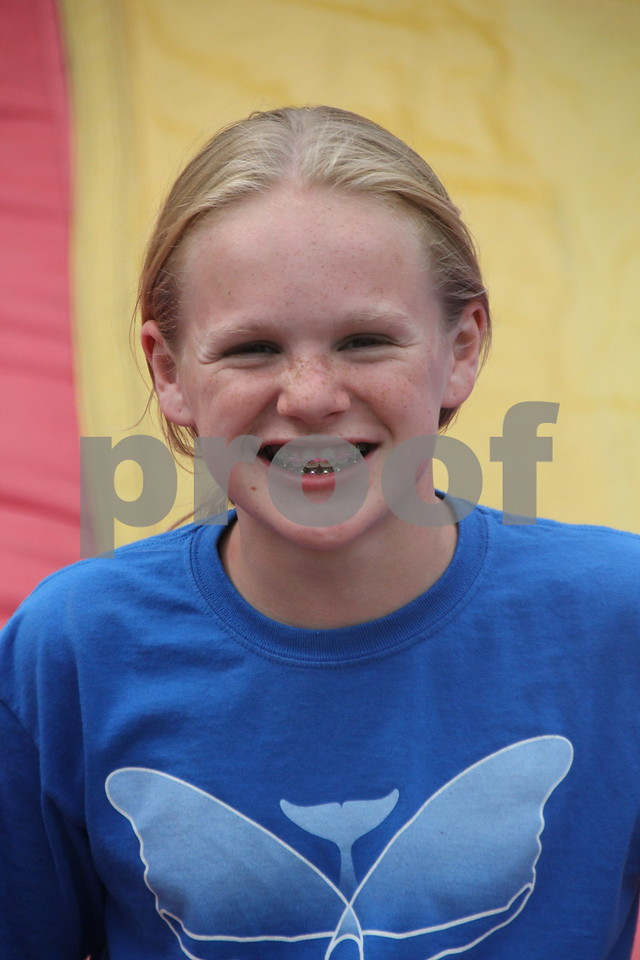 Rylie Steinkamp takes time out from her fun on the inflatables to get her picture taken on Friday, July 10, 2015.