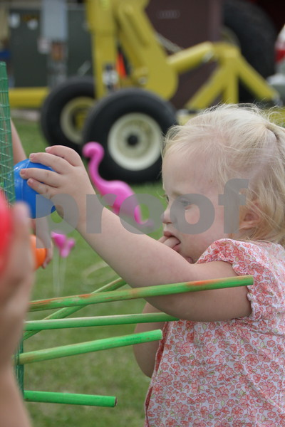 Kaitlin O'Halloran returns a ball to the  large version of the  Kerplunk game at the Webster County Fair on Friday, July 10, 2015.