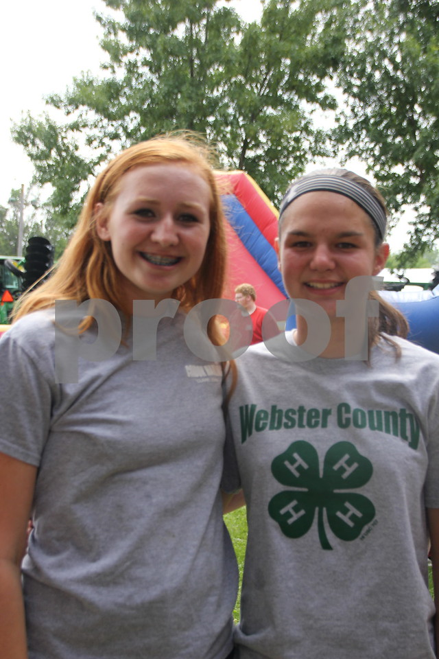Jaedyn Condon (Left ) and Sidney Messerly (Right), are seen here at the inflatable slide, just one of the options for fun available  to kids at the Webster County Fair on Friday, July 10, 2015.