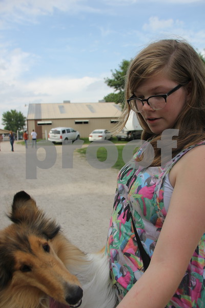 Carlie Shing-Hon and her dog Crystal enjoy the many activities of the Webster County Fair on Friday, July 10, 2015.