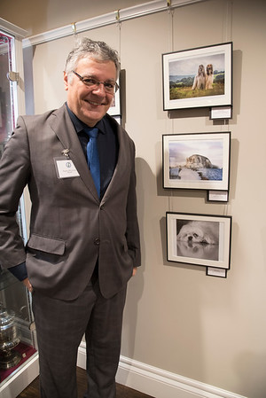 Rogerio (Roger) Silva Araujo from Brazil next to his award winning photograph